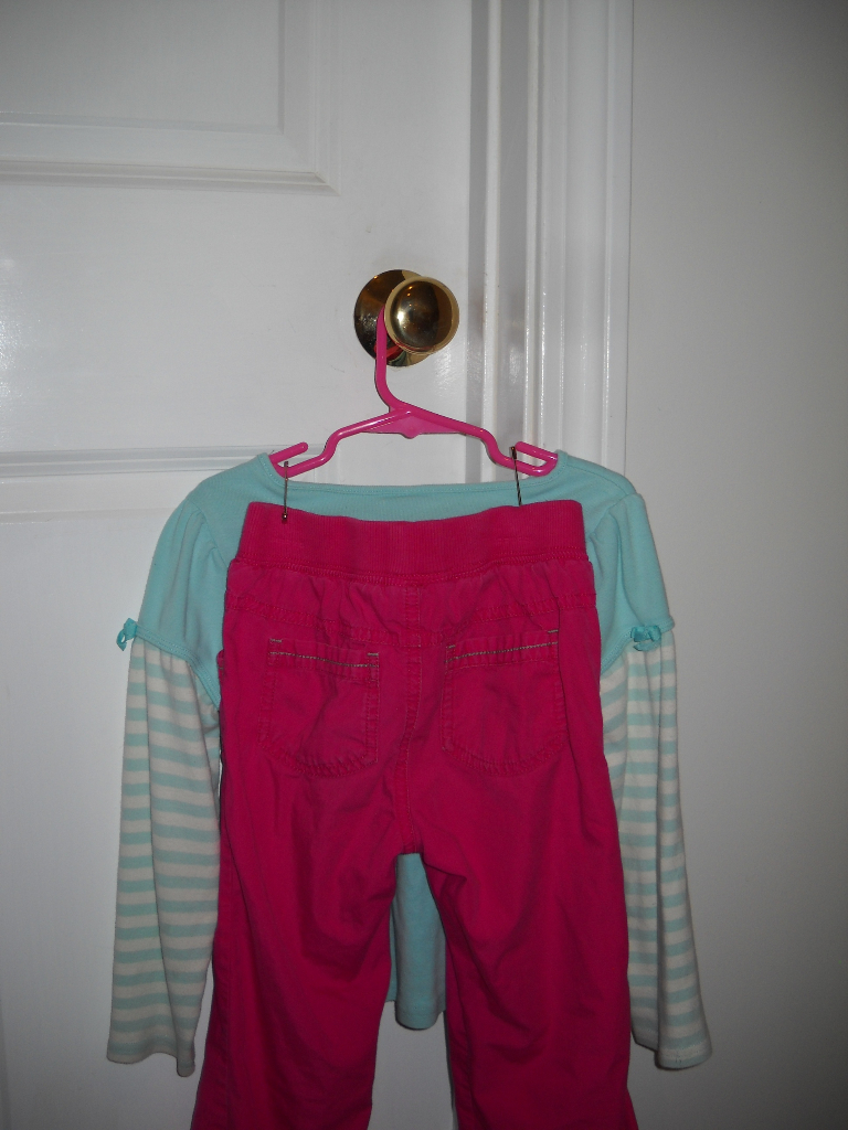 A shirt/pants set, connected using safety pins