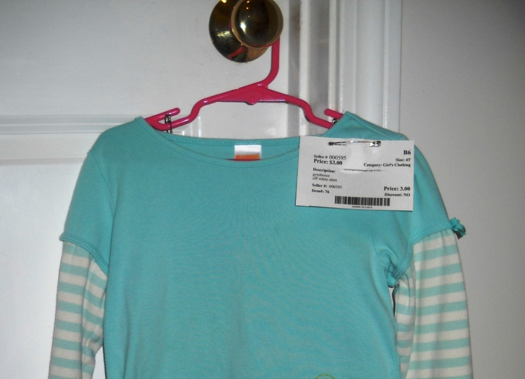 Shirt on hanger with hook opening facing left, like a question mark